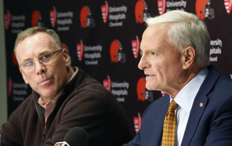 Cleveland Browns owner Jimmy Haslam, right, introduces the NFL football teams new general manager, John Dorsey, left, during an introductory press conference in Berea, Ohio, Friday, Dec. 8, 2017.  (John Kuntz/The Plain Dealer via AP)