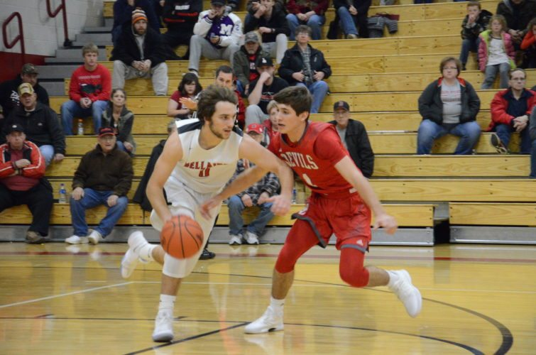 Photo by Kim North Bellaire's Mason Ramsay, left, dribbles the ball as St. Clairsville's Matt Busby guards during Friday's game on Guernsey Street.