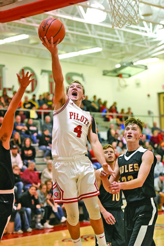 Photo by Katie Parks River's Lukas Isaly drives to the basket during Friday's game against Monroe Central.