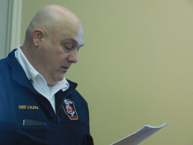 Photo by Robert A. DeFrank Cumberland Trail Fire District Chief John Slavik addresses the Belmont County Board of Commissioners regarding possible compensation for services provided to the county jail. The board is awaiting the prosecutor's legal opinion.