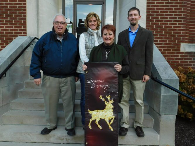 Photo by Robert DeFrank New banners are on display in St. Clairsville, thanks in large part to a donation from Hull & Associates. Shown from left are Mayor Terry Pugh; Pam Carman Rine, marketing and event coordinator with the St. Clairsville Area Chamber of Commerce; Wendy Anderson, director of the chamber; and A.J. Smith, office manager with Hull & Associates.