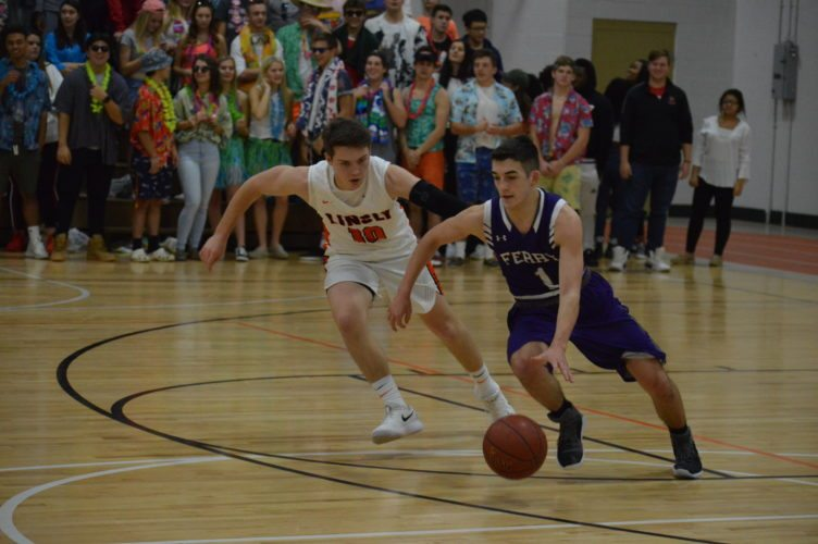 Photo by Josh Strope Martins Ferry's Logan Powell (1) takes the ball up the floor as Linsly's Jon Milton (10) defends during Saturday's game in Wheeling.
