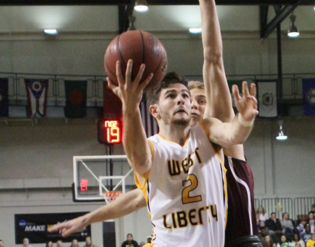Photos Provided by West Liberty Athletics West Liberty's Dan Monteroso goes in for a layup during Saturday's game against Fairmont State. The Hilltoppers defeated the Falcons, 106-100, to remain undefeated.