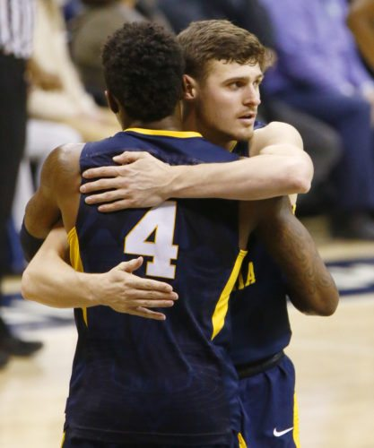 West Virginia's Chase Harler, right, hugs Daxter Miles Jr. after West Virginia defeated Pittsburgh 69-60 in an NCAA college basketball game, Saturday, Dec. 9, 2017, in Pittsburgh. (AP Photo/Keith Srakocic)