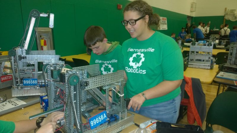 Photo by Jennifer Compston-Strough Jerney Fox, left, a seventh-grader at Barnesville Middle School, works with teammate Olivia Toliver, an eighth-grader, to prepare their robot for a final round of competition at the school on Saturday.
