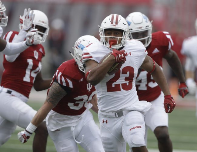 FILE - In this Nov. 4, 2017, file photo, Wisconsin running back Jonathan Taylor (23) carries during the first half against Indiana in an NCAA college football in Bloomington, Ind. Taylor finished sixth in the Heisman Trophy voting this and depending on what the juniors do ahead of him, he could be the highest placing returnee. (AP Photo/Darron Cummings, File)