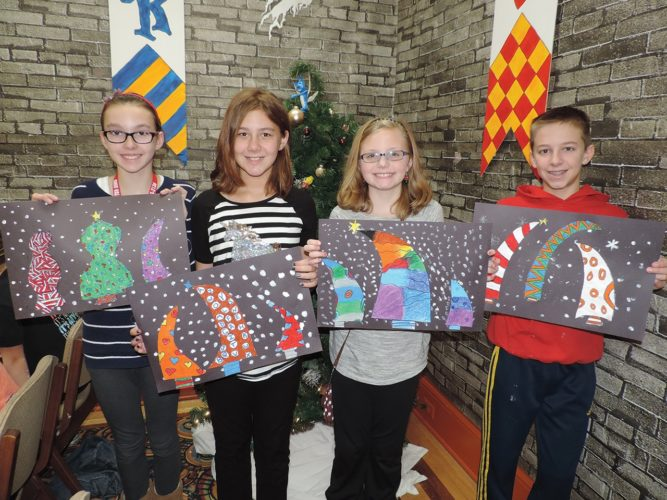 Photo Provided From left to right with their Dr. Seuss trees artwork at last year's Holiday Art Camp at Stifel Fine Arts Center are Olivia Albrecht, Autumn Cerklefskie, Avery Sadlowski and Noah Seivertson.