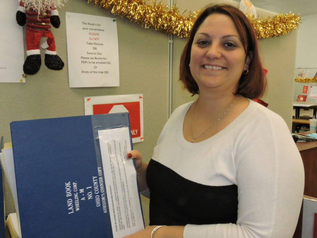 Photo by Casey Junkins Ohio County Assessor Tiffany Hoffman reviews property records in her office.