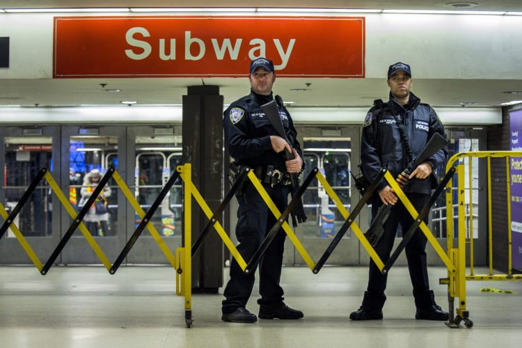Police stand guard inside the Port Authority Bus Terminal following an explosion near Times Square on Monday, Dec. 11, 2017, in New York. Police said a man with a pipe bomb strapped to his body set off the crude device in a passageway under 42nd Street between Seventh and Eighth Avenues. (AP Photo/Andres Kudacki)