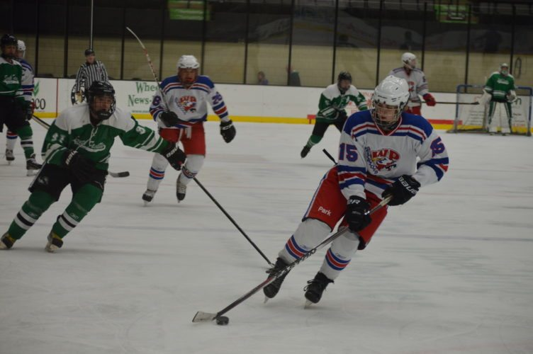 Photo by Cody Tomer Wheeling Park's Jacob Miller controls the puck down the ice during Monday's game at WesBanco Arena with South Fayette.