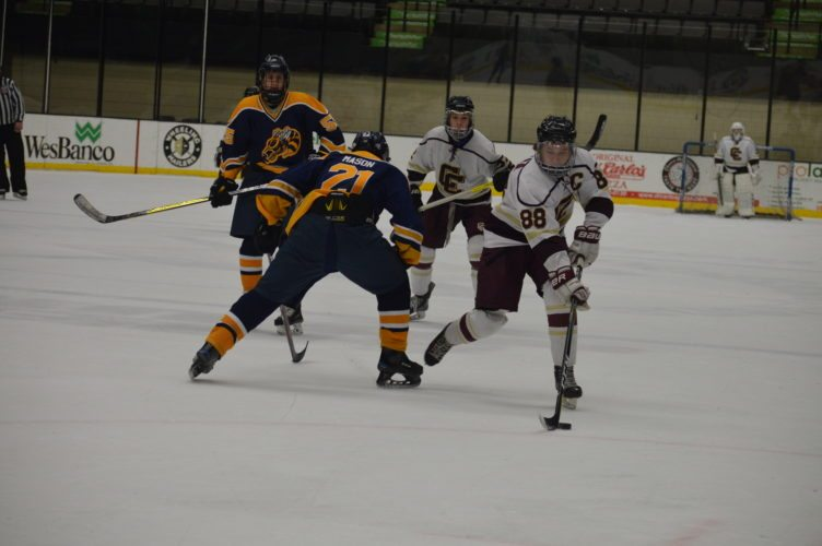 Photo by Cody Tomer Wheeling Central captain Chase Kelly (88) beats Freeport defender Jack Mason (21) during Monday's high school hockey action.