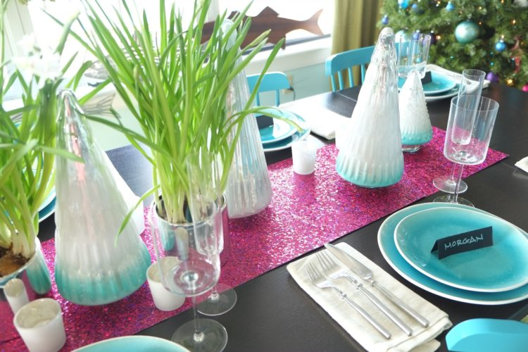 AP Photos To add some unexpected sparkle to a holiday table, Massachusetts-based interior designer Kristina Crestin used sheets of raspberry-colored metallic craft paper as a table runner paired with paperwhite plants in silver-toned metal pots.