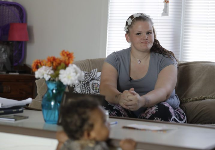 Shawnee Wilson watches as her son, Kingston, plays in her apartment in Indianapolis, on Tuesday, Aug. 8, 2017. Despite some relapses, she's been clean several months and is convinced she'll be able to keep it up. The clock is ticking. Federal law dictates the loss of parental rights for those whose children have been in foster care for 15 out of the previous 22 months.  (AP Photo/Darron Cummings)