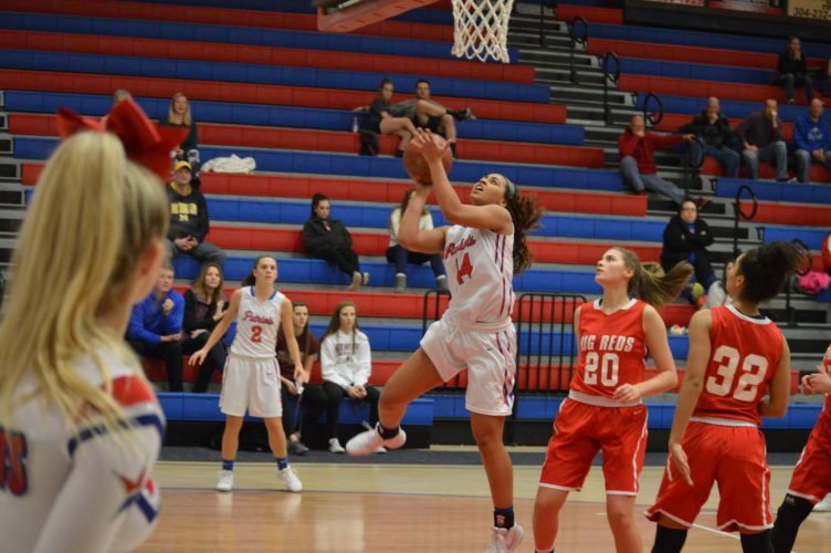 Photo by Kyle Lutz Wheeling Park's Bella Abernathy goes in for a layup while Parkersburg's Aleea Crites looks on during Tuesday night's game.