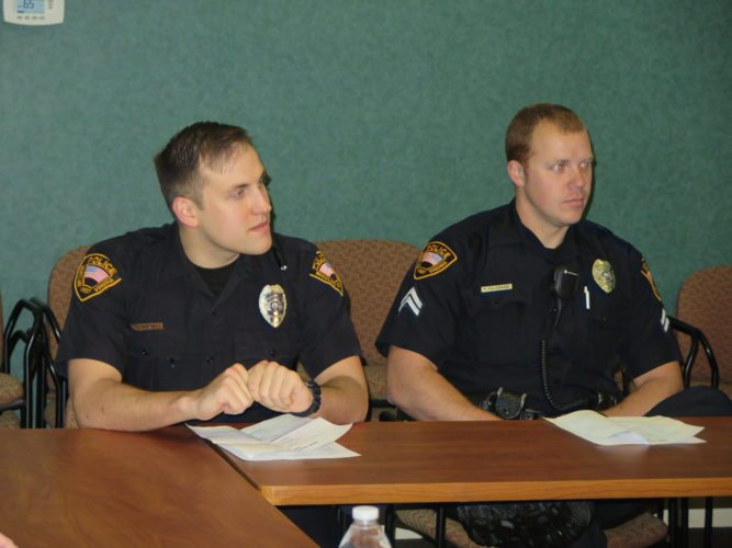 Photo by Joselyn King Wheeling Police Department officers Gage Parker, left, and R.J. Faldowski participate in a discussion on local law enforcement Wednesday at the First State Capitol building in Wheeling, organized by Ohio Valley Together.