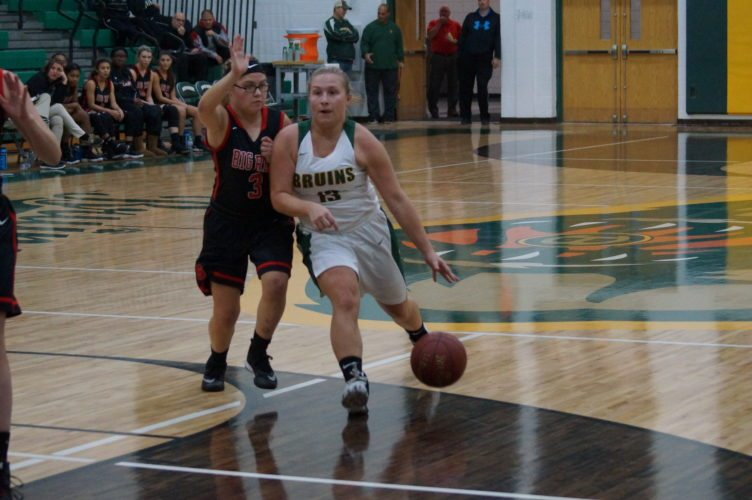Photo by Andrew Grimm / Brooke's Marissa Elliott (13) drives to the basket while being defended by Steubenville's Seana Ragusa during their game Wednesday night in Wellsburg.
