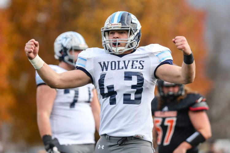 Sholten Singer/The Herald-Dispatch  Spring Valley's Owen Porter celebrates a play as the Wolves take on Martinsburg in the Class AAA Super Six State Championship on Saturday, Dec. 2, 2017, at Wheeling Island Stadium.