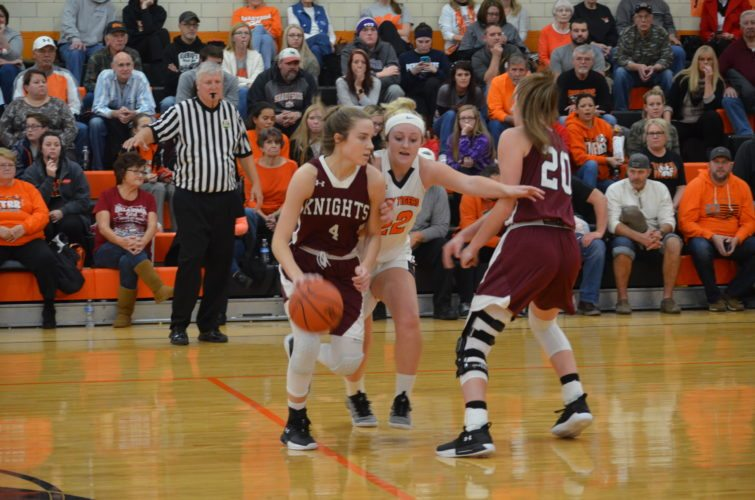 Wheeling Central's Eden Gainer (4) drives past Shadyside's Jaycee Mayeres (22) as the Maroon Knights' Kaylee Reinbeau prepares to set a screen during Thursday night's game.