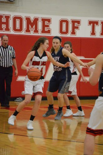 Photo by Kim North Union Local's Sutherland Butler looks to get around the defense of Buckeye Local's Carrie Dill.