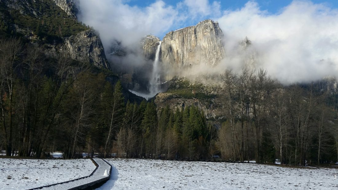 This undated image provided by the National Park Service shows Yosemite Falls in Yosemite National Park in California in winter. The park is less crowded in winter and offers solitude, scenery and activities like hiking, snowshoeing, skiing and ice skating. (NPS Photo via AP)