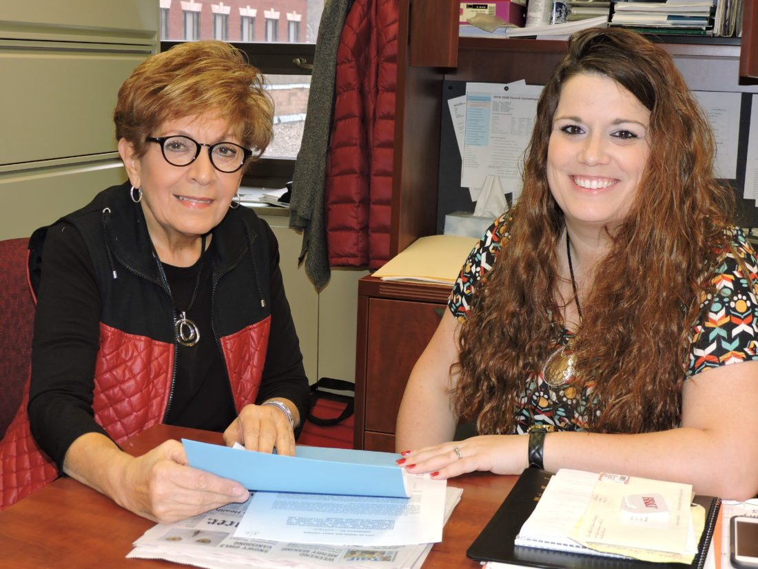 """New Wheeling City Clerk Brenda J. """"B.J."""" Delbert, right, continues learning the ropes from longtime Clerk Janice Jones, whom she will replace in January."""