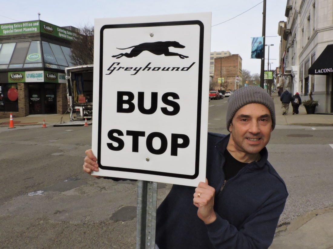 Photo by Casey Junkins Patrick Viola, owner of Security Travel, which operates Wheeling's Greyhound ticket office, hopes the new bus stop outside the McLure Hotel will satisfy all parties involved.