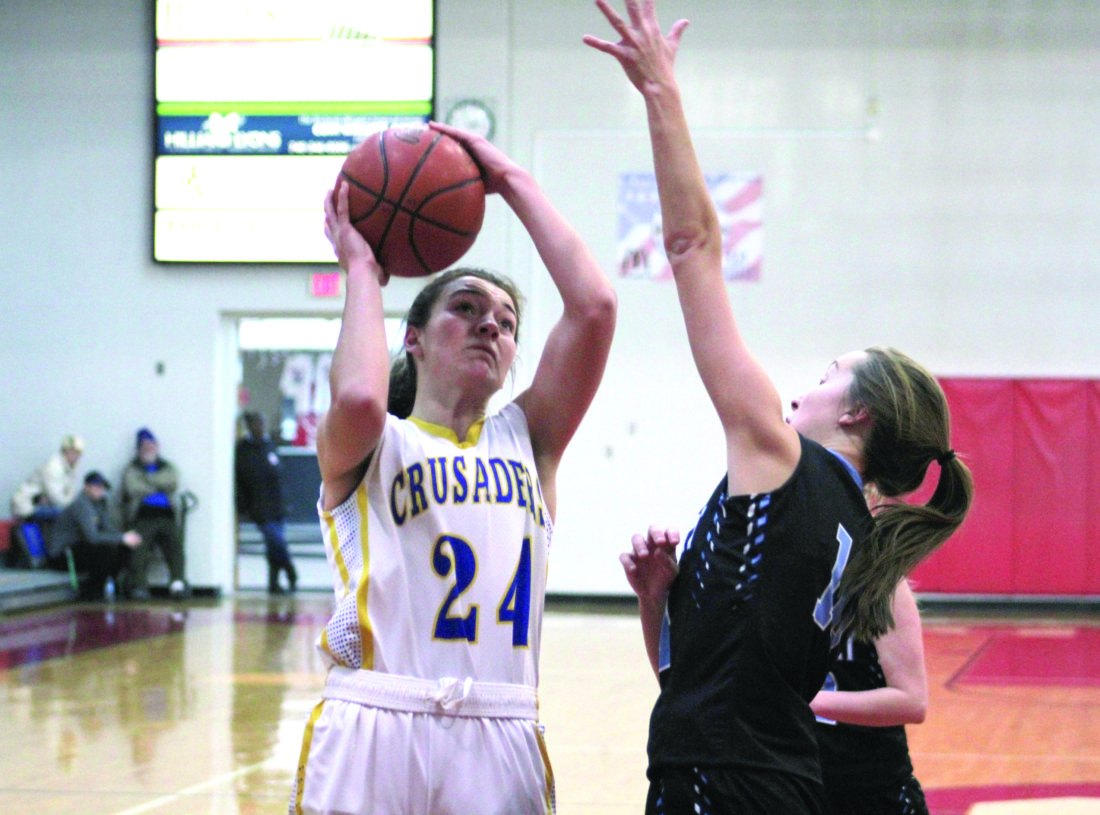 Photo by Joe Catullo Steubenville Catholic's Isabella Oliver attempts a shot while Bridgeport's Marissa Beal goes in for a block.