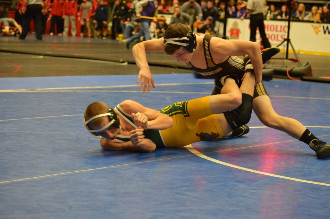 Photos by Cody Tomer John Marshall's Ethan Gray makes a move against Brooke's Braydon DeMaria in a 113 battle during Thursday's Wheeling Park Duals at WesBanco Arena.