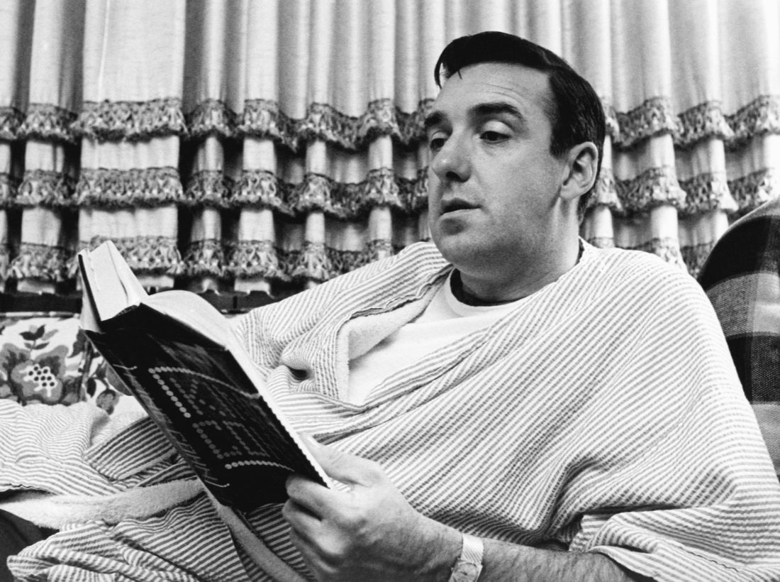 "FILE - In this Nov. 14, 1967 file photo, singer and actor Jim Nabors, best known for his role as Gomer Pyle on ""The Andy Griffith Show,"" reads a book at his California home. Nabors was among the notable figures who died in 2017.  (AP Photo/File)"