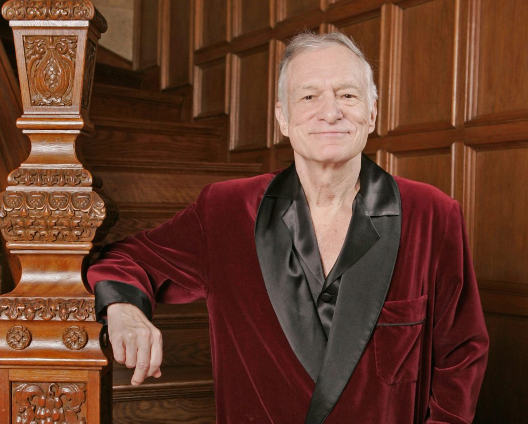 FILE - In this April 7, 2006 file photo, Playboy founder Hugh Hefner poses at the Playboy Mansion in the Holmby Hills area of Los Angeles.  Hefner was among the notable figures who died in 2017.  (AP Photo/Kevork Djansezian, File)