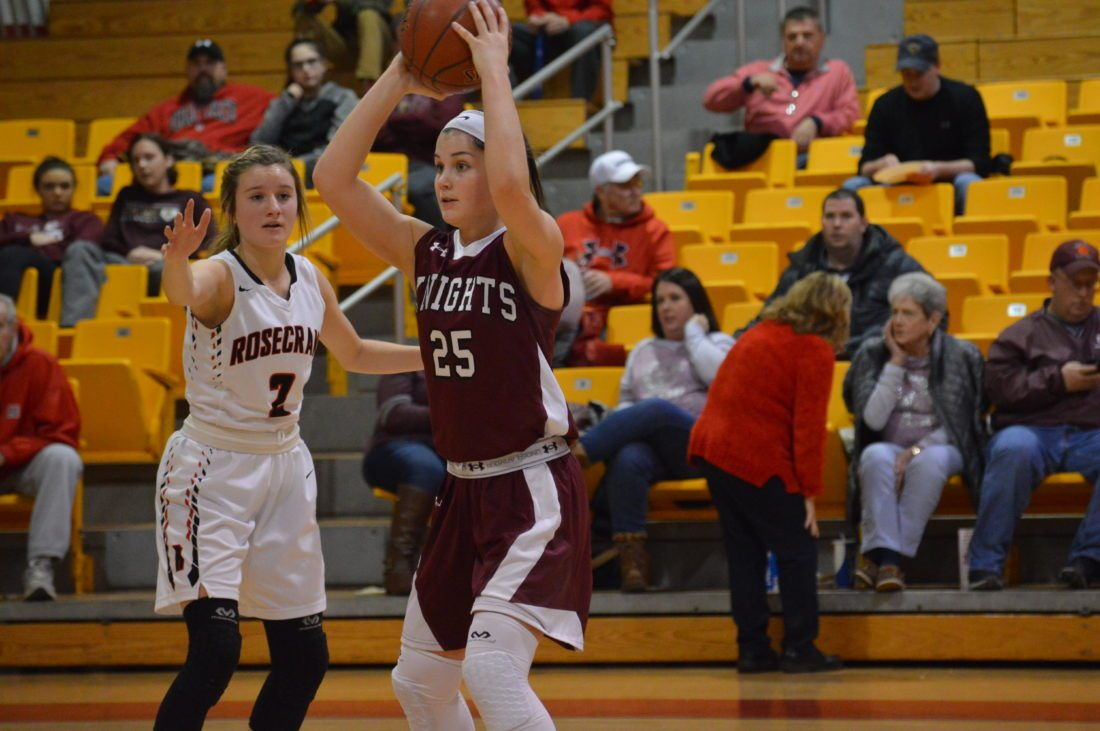 Photo by Kyle Lutz Wheeling Central's Taylor Duplaga (25) looks for someone to pass to as Bishop Rosecrans' Kailey Zemba defends.