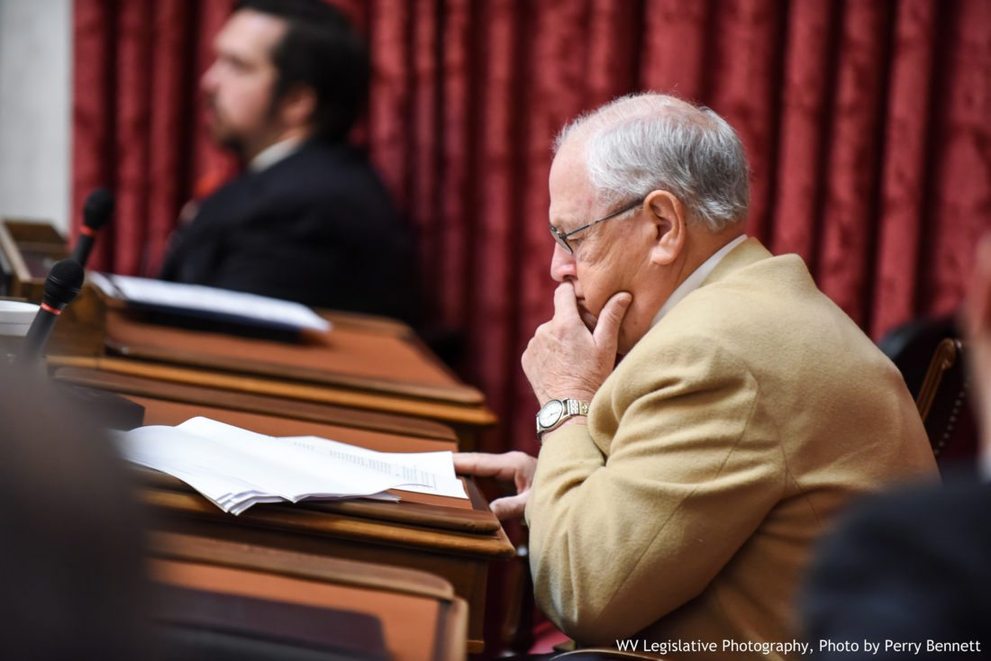 """Photo by Perry Bennett, W.Va. Legislature West Virginia Delegate William """"Roger"""" Romine, R-Tyler, reviews documents during a House of Delegates floor session earlier this year."""