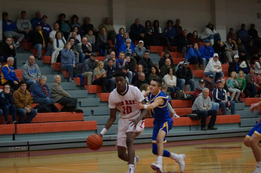 Photo by Andrew Grimm Steubenville's Trillyun Jones (10) dribbles down court past a Steubenville Catholic defender in Saturday's game.