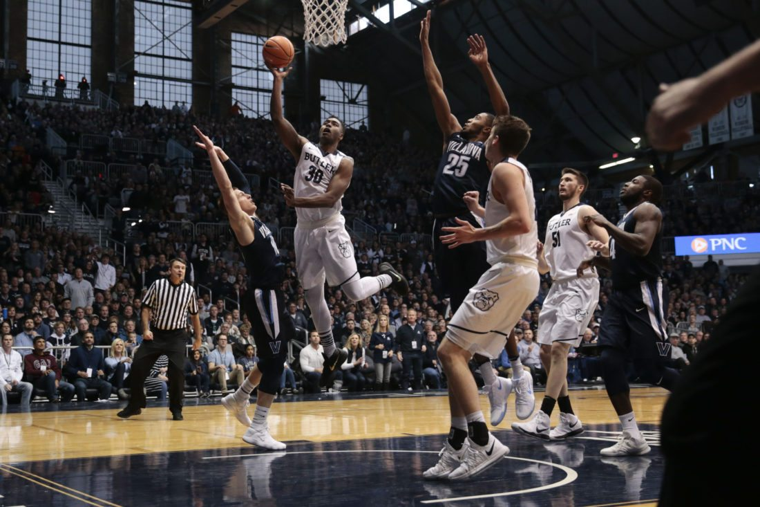 Butler forward Kelan Martin (30) shoots between Villanova defenders Donte DiVincenzo (10) and Mikal Bridges (25) in the first half of an NCAA college basketball game in Indianapolis, Saturday, Dec. 30, 2017.(AP Photo/AJ Mast)