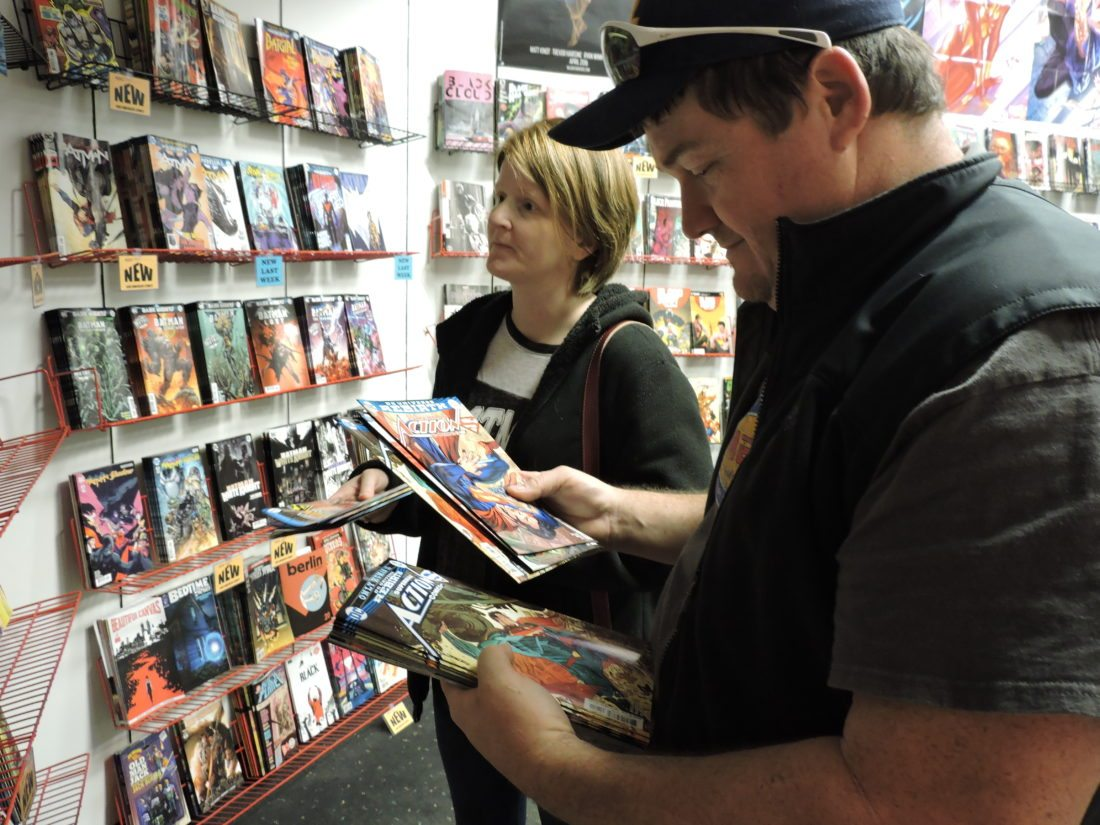 Ray and Amy VanSyoc look over the comic selection at New Dimension Comics. (Photos by Dylan McKenzie)