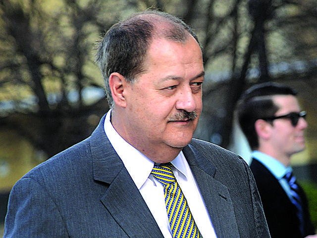 FILE - In a Wednesday, April 6, 2016 file photo, former Massey CEO Don Blankenship is escorted by Homeland Security officers from the Robert C. Byrd U.S. Courthouse in Charleston, W.Va. Blankenship, who was sentenced to a year in jail and a $250,000 fine for his role in the Upper Big Branch Mine explosion,  has declared himself an ÒAmerican political prisonerÓ on his blog, blaming others for the 2010 mine explosion that killed 29 men and led to the former West Virginia coal operatorÕs imprisonment. The ex-Massey Energy CEO said he plans to distribute 250,000 copies of the 67-page diatribe in booklet form.  (F. Brian Ferguson/Charleston Gazette-Mail via AP, File)