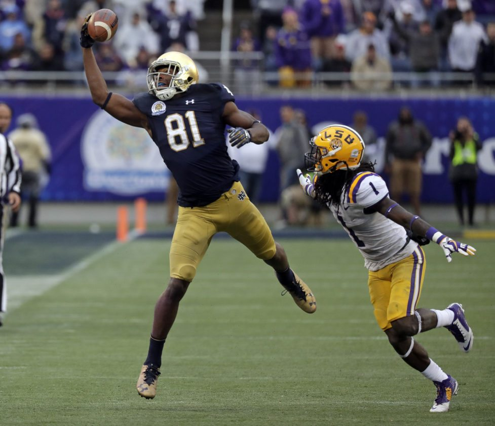 Notre Dame wide receiver Miles Boykin (81) makes a one handed catch in front of LSU defensive back Donte Jackson (1) for a 55-yard game winning touchdown during the second half of the Citrus Bowl NCAA college football game, Monday, Jan. 1, 2018, in Orlando, Fla. Notre Dame won 21-17. (AP Photo/John Raoux)