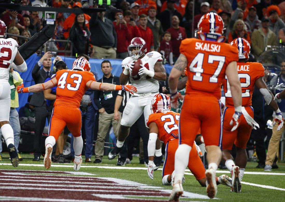 Alabama defensive lineman Da'Ron Payne (94), who was used on an offensive play, pulls in a touchdown reception in the second half of the Sugar Bowl semi-final playoff game against Clemson for the NCAA college football national championship, in New Orleans, Monday, Jan. 1, 2018. (AP Photo/Butch Dill)