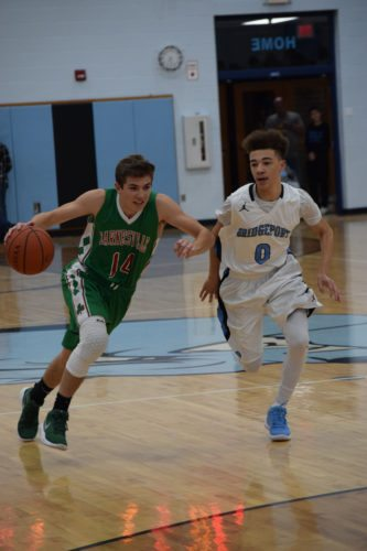 Photo by Seth Staskey Barnesville's Tate Dowler dribbles up court, while Bridgeport's Trevonn Ray defends during Tuesday's contest at Bridgeport High School. Barnesville emerged victorious by a final score of 67-50.