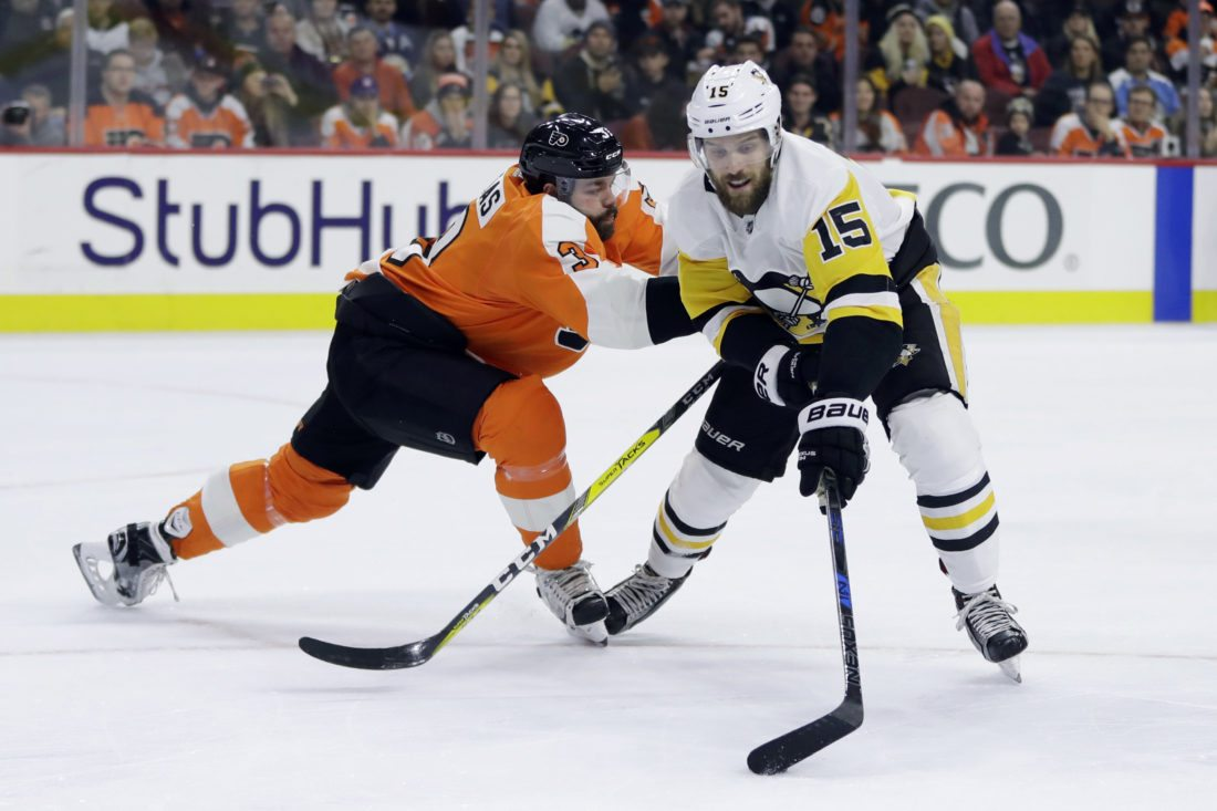 Pittsburgh Penguins' Riley Sheahan, right, tries to get past Philadelphia Flyers' Radko Gudas during the first period of an NHL hockey game, Tuesday, Jan. 2, 2018, in Philadelphia. (AP Photo/Matt Slocum)