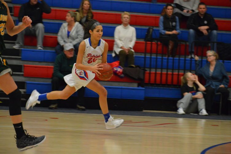 Photo by Cody Tomer Wheeling Park's Asia Roby races down the court on Wednesday as she looks for an open passing lane in a game against Brooke at The Palace.