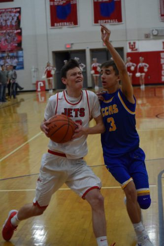 Union Local's Elijah Baker, left, tries to get around the defense of Steubenville Catholic's A.J. Connor on Wednesday.