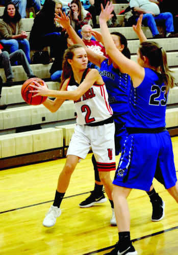 Photo by Seth Staskey Union Local's Casey Kildow (2)is double-teamed by Harrison Central defenders Aex Wiley and Lexee McAfee on Thursday night.