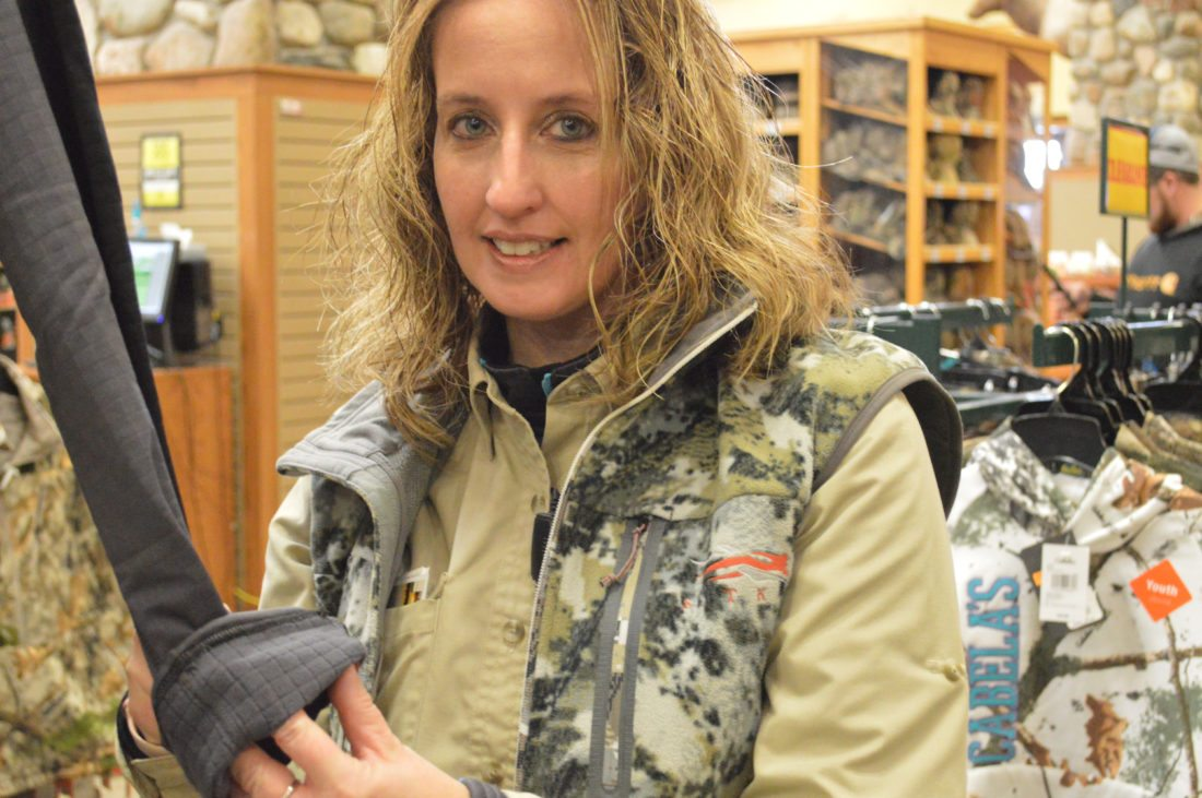 Photos by Betsy Bethel Teresa Riley, sales floor outfitter at Cabela's at The Highlands in Triadelphia, shows a Cabela's base layer with specially designed cells inside to trap warm air from the body. Layering is key to staying warm in the Arctic weather that the Ohio Valley has been experiencing.