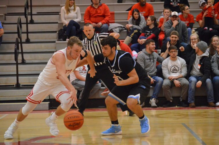 Photo by Rick Thorp River's Lukas Isaly (4)looks to drive around Bridgeport defender Jeremiah Booker during their game Friday night at R.L. Potts Gymnasium.