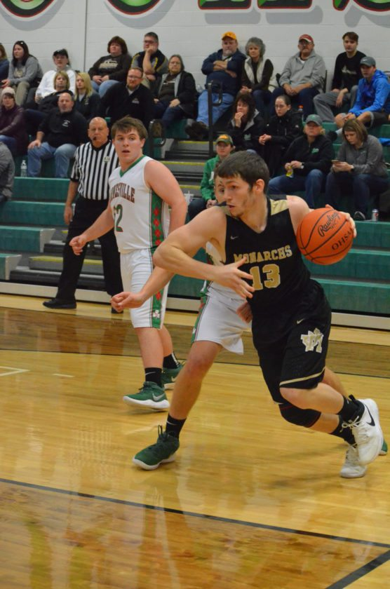 Photo by Rick Thorp John Marshall's Devin Norris drives the baseline during Tuesday's victory against Barnesville.