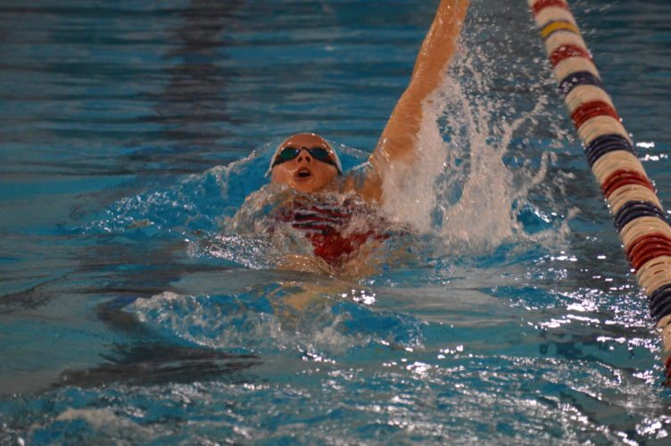 Wheeling Park's Sarah Heilman takes part in the 100 backstroke during  Tuesday's swim meet at Wheeling Park.     Photo by  Cody Tomer