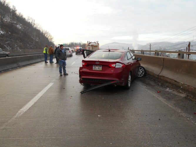 Photo Provided Multiple cars are damaged after sliding on black ice Wednesday morning on W.Va. 2 near Benwood.