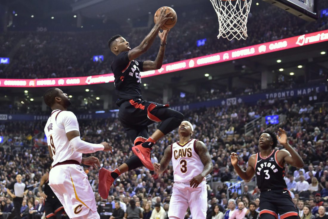 Toronto Raptors guard Delon Wright goes up for a basket past Cleveland Cavaliers guard Dwyane Wade and guard Isaiah Thomas as Raptors forward OG Anunoby watches during the first half of an NBA basketball game Thursday Jan. 11 2018 in T
