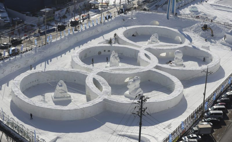 Visitors tour near the snow sculpture in the shape of the Olympic rings displaying at the Daegwanryung Snow festival in Pyeongchang, South Korea, in February.  Pyeongchang is the host city of the 2018 Olympic and Paralympic Winter Games, which will start next month.  AP File Photo